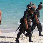 Soldaten am Strand in Mexiko  Bild (Ausschnitt): ©  zanzibar [CC BY-NC 2.0]  - flickr