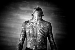 Chelatenango, El Salvador. May 2007. A members of the Mara Salvatrucha gang displays his tattoos inside the Chelatenango prison in El Salvador.